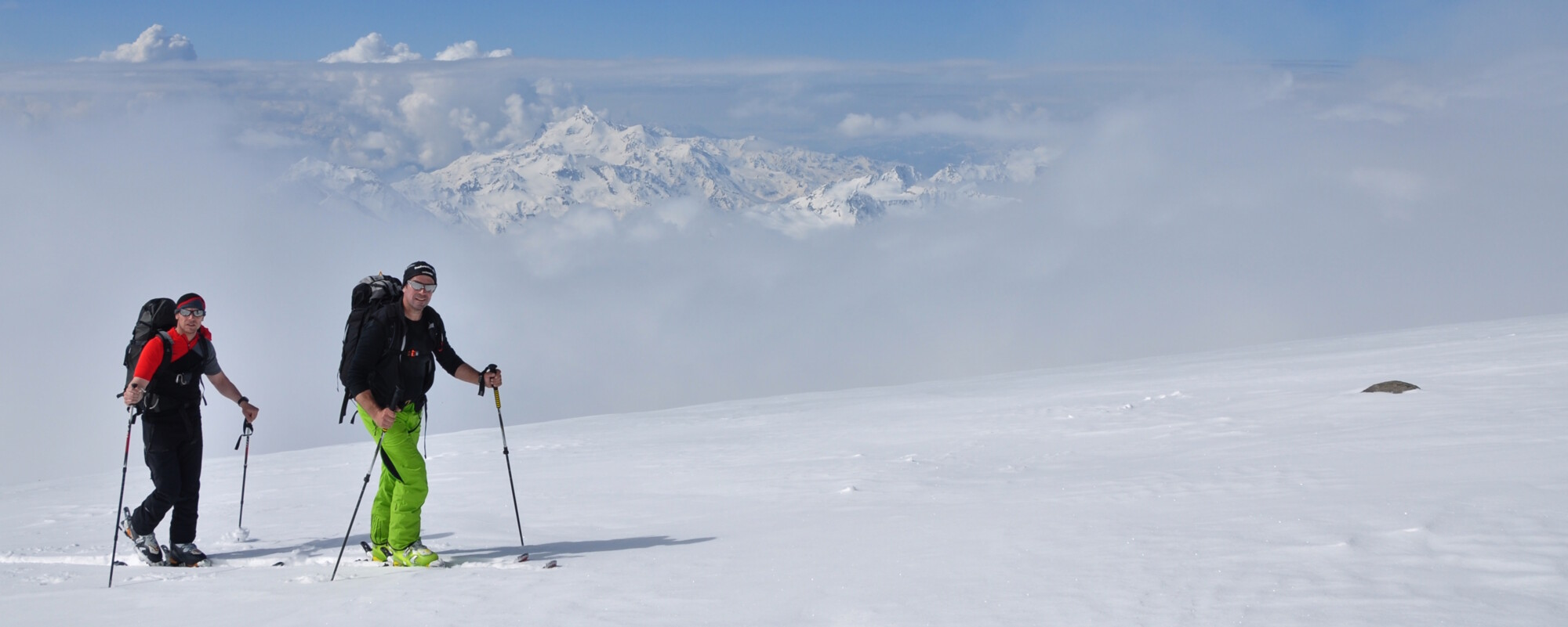 Elbrus Ski Mountaineering - Climb and Ski Elbrus, 2 members on skis.
