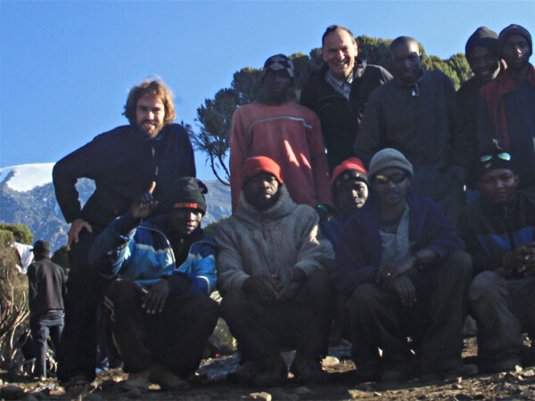Professionell climber Felix Berg and our team infront of Kilimanjaro