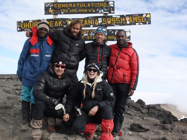 Felix Berg with some of our members and guides on top of Kilimanjaro. Summit Climb Tansania.