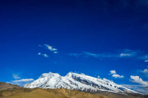 Climb this 7500m giant overlooking the Taklamakan desert. SummitClimb, your altitude mountain experts.