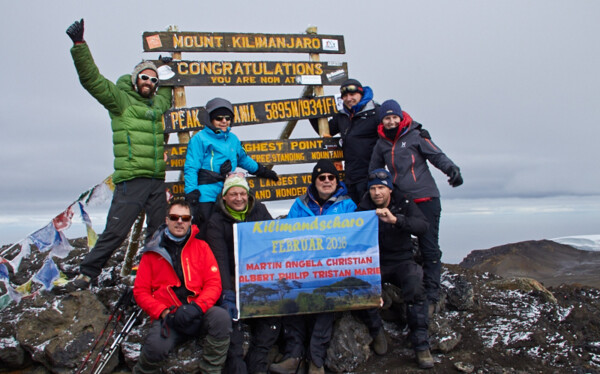 Summit: Special group with specialist leader on the top of Kilimanjaro, Uhuru Peak, 5,985m / 19,341ft.