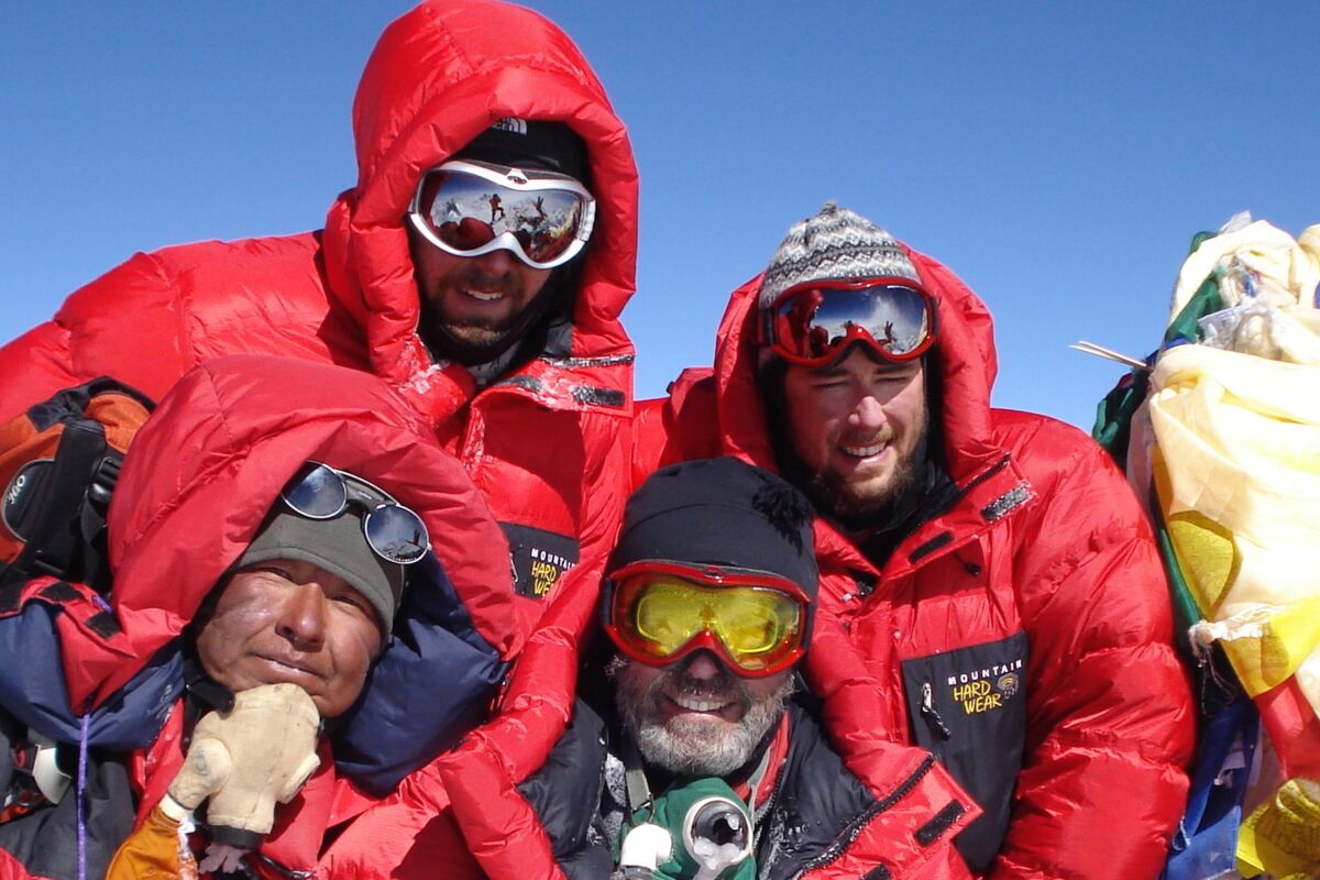 Mountaineers on the summit of Everest, Jungbu Sherpa and our clients. | © SummitClimb Nepal