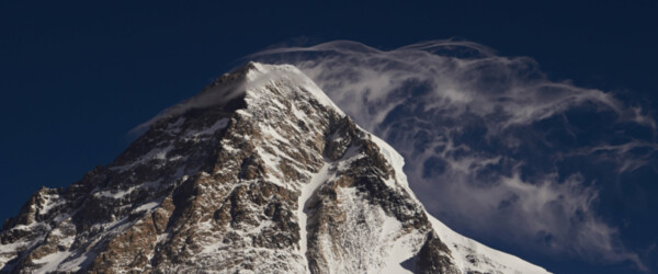 K2, the mighty 2nd highest mountain of the world, clouds playing around the summit.