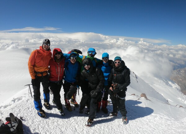 Elbrus: Team on the summit in 2019 with Magdalena Wilczek.